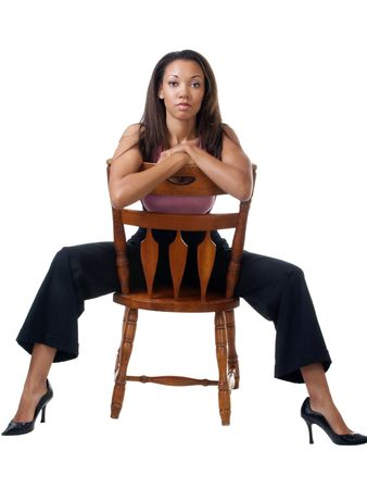 Young black woman in pants outfit sitting on chair backwards Stock Photo - 4056219