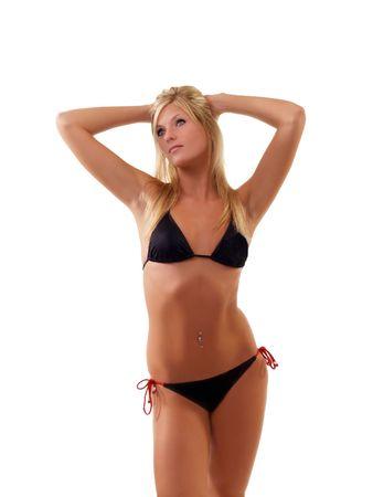 Fit blond woman standing in black bikini        写真素材