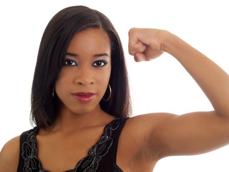strong: Portrait of black woman showing strong left arm