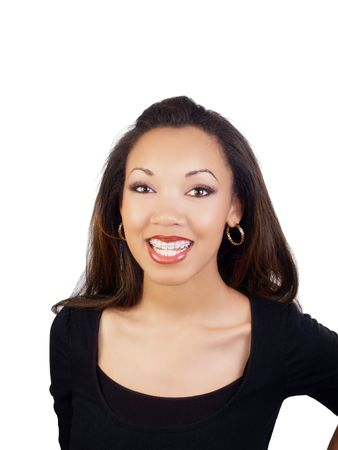 Smiling portrait of young black woman with braces on upper teeth        写真素材