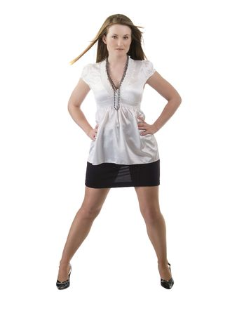 Young woman standing with arms akimbo black skirt white blouse