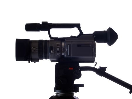 tripod mounted: mid-range video camera mounted on tripod from the side