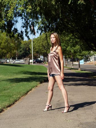 Asian American woman in shorts and heels
