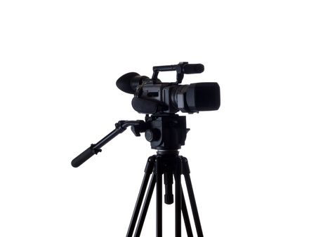 tripod mounted: Mid-range video camera mounted on tripod black    Stock Photo