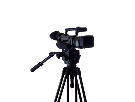 tripod mounted: Mid-range video camera mounted on tripod black    Stock Photo