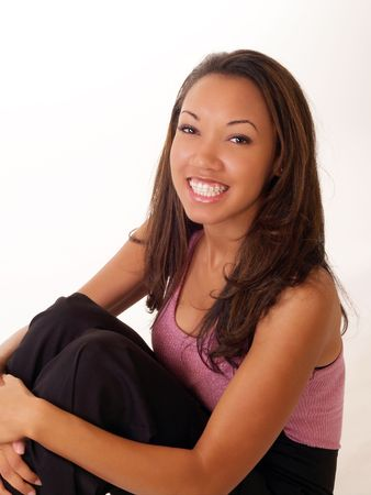 Pretty young black woman with braces on upper teeth
