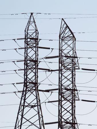 Power lines filling frame against blue sky     版權商用圖片