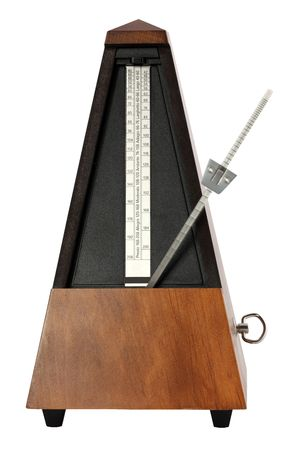 Wooden windup music metronome on white background photo