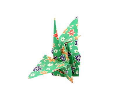 Closeup of oragami paper crane green with colorful patterns Banco de Imagens