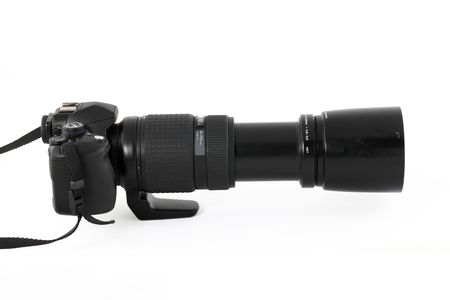 Black mid-ranged digital SLR camera from side with long lens
