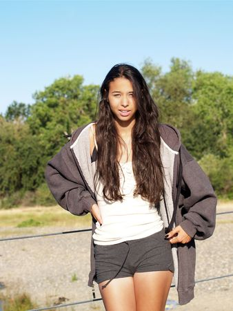 Young woman of mixed ethnicity outdoors in shorts