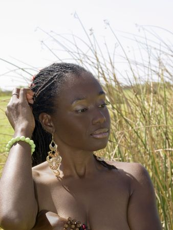 Young African American woman topless outdoors arms over breast Stock Photo - 6436902