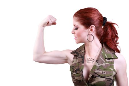 flexed: Attractive redhead woman showing flexed bicep muscle