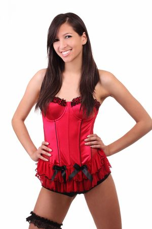 Young skinny woman in red corset with black garter