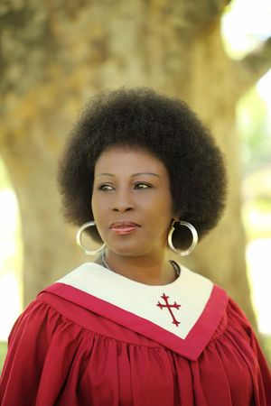 Middle Aged Black woman outdoors red church robes