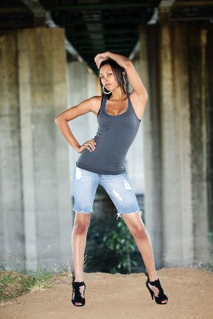 cutoff: Young African American woman in cutoff jeans outdoors