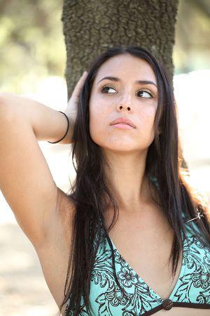 Young woman in blue bikini top portrait outdoors photo