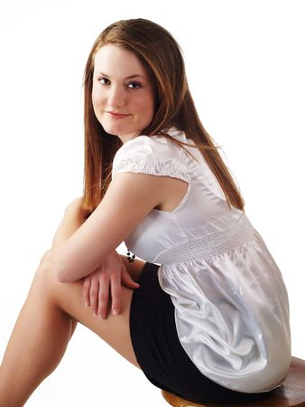 Young caucasian woman sitting confident and relaxed side view looking at camera photo
