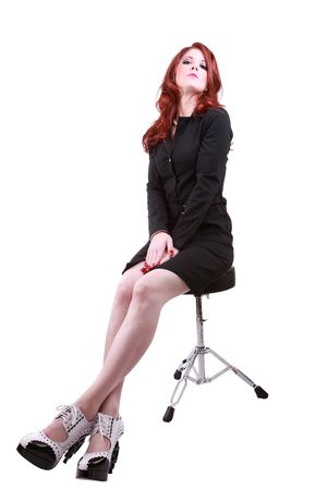 stool: Young woman red hair legs distorted on stool dress