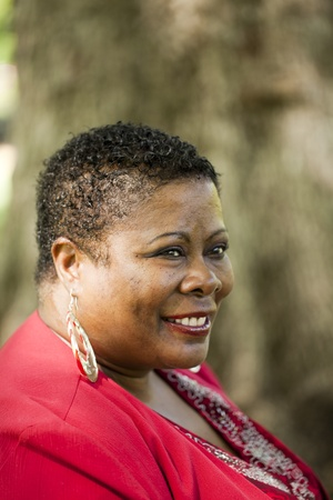 Middle aged African American woman outdoors portrait red top Stock Photo - 8631792