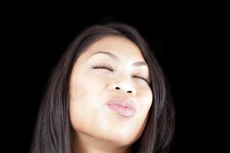puckered: Young woman portrait puckered lips eyes closed