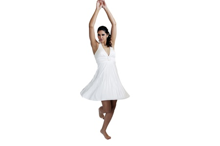 Young caucasian woman twirling in white dress