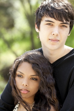 Young teen attractive couple outdoor portrait boy and girl