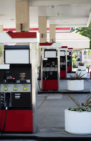 across: 4 gas pumps across different islands without cars Stock Photo