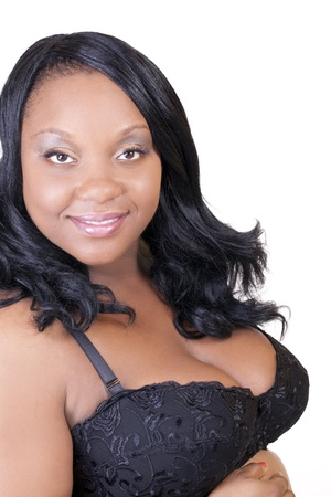 Young plus-size African American pregnant woman smiling photo