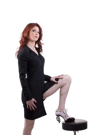 Young caucasian woman business outfit foot on stool
