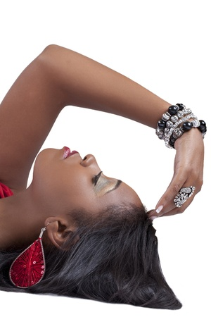 woman profile: Attractive African American Woman reclining profile arm