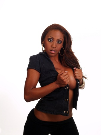 Attractive black woman standing with open vest showing cleavage
