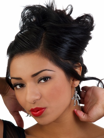 Young latina woman portrait red lipstick and skeleton earrings