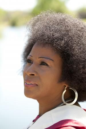 Older Attractive Black woman outdoor portrait church robes