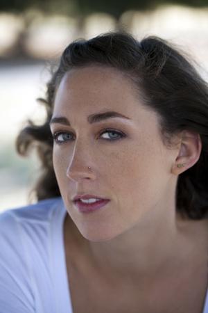 Attractive young caucasian woman outdoor portrait freckles