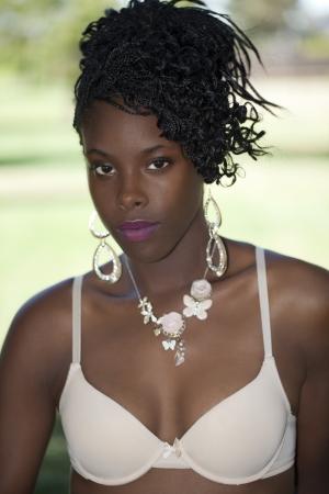 Attractive skinny African American woman outdoor portrait bra photo