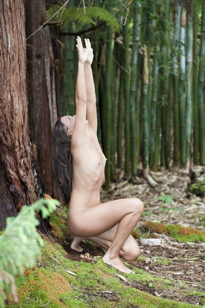 naked woman breasts: Young nude woman outdoors arms reaching upwards