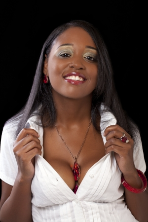 Young black woman holding white shirt showing cleavage
