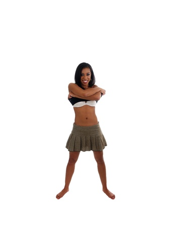 undressing woman: Young African American Woman pulling off shirt
