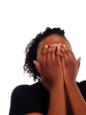 completely: Young Black woman with hands completely covering face Stock Photo