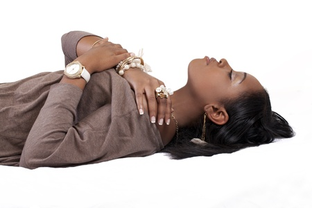 Young Black woman profile shot reclining on back photo