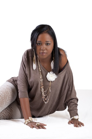 Young Black Woman Sitting on Floor Sultry Stockings