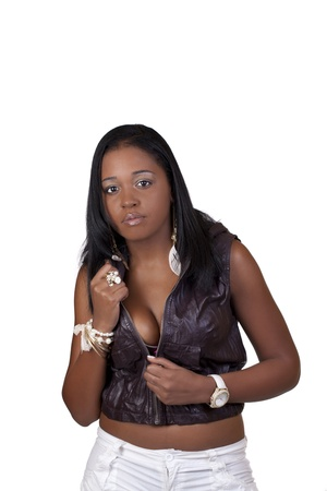 Young Black Woman Unzipping Top Showing Cleavage photo