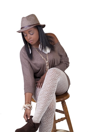 Young Black Woman in Hat and Textured Stockings