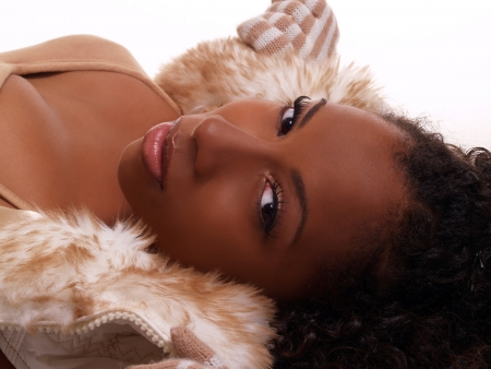 sultry: portrait young attractive black woman reclining sultry
