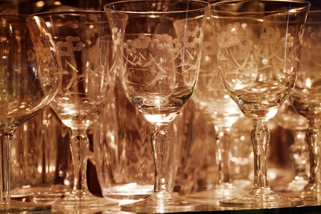 Glassware on Display in Lit Glass Cabinet Фото со стока