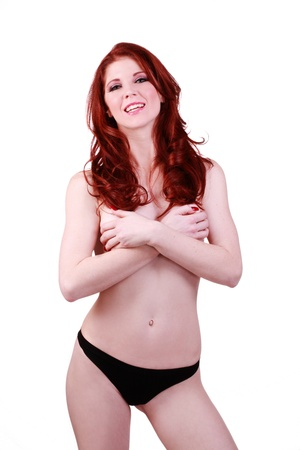 implied: Young Caucasian Woman Implied Nude Panties Redhead Stock Photo