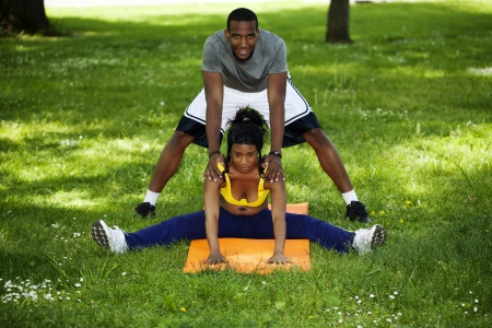 Young African American Man and Woman Exercising photo