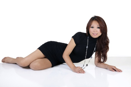 Young Oriental Woman Black Dress and Necklace Stock Photo