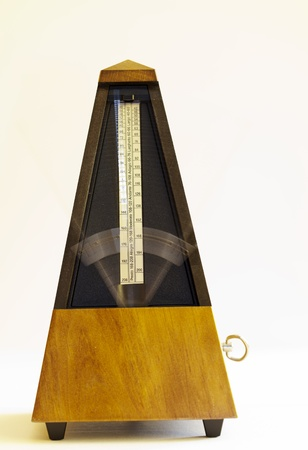 Metronome With Blurred Arm Moving Wooden Mechanical Stock Photo - 18957941
